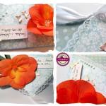 Ślubna kopertówka z pomarańczowym kwiatem